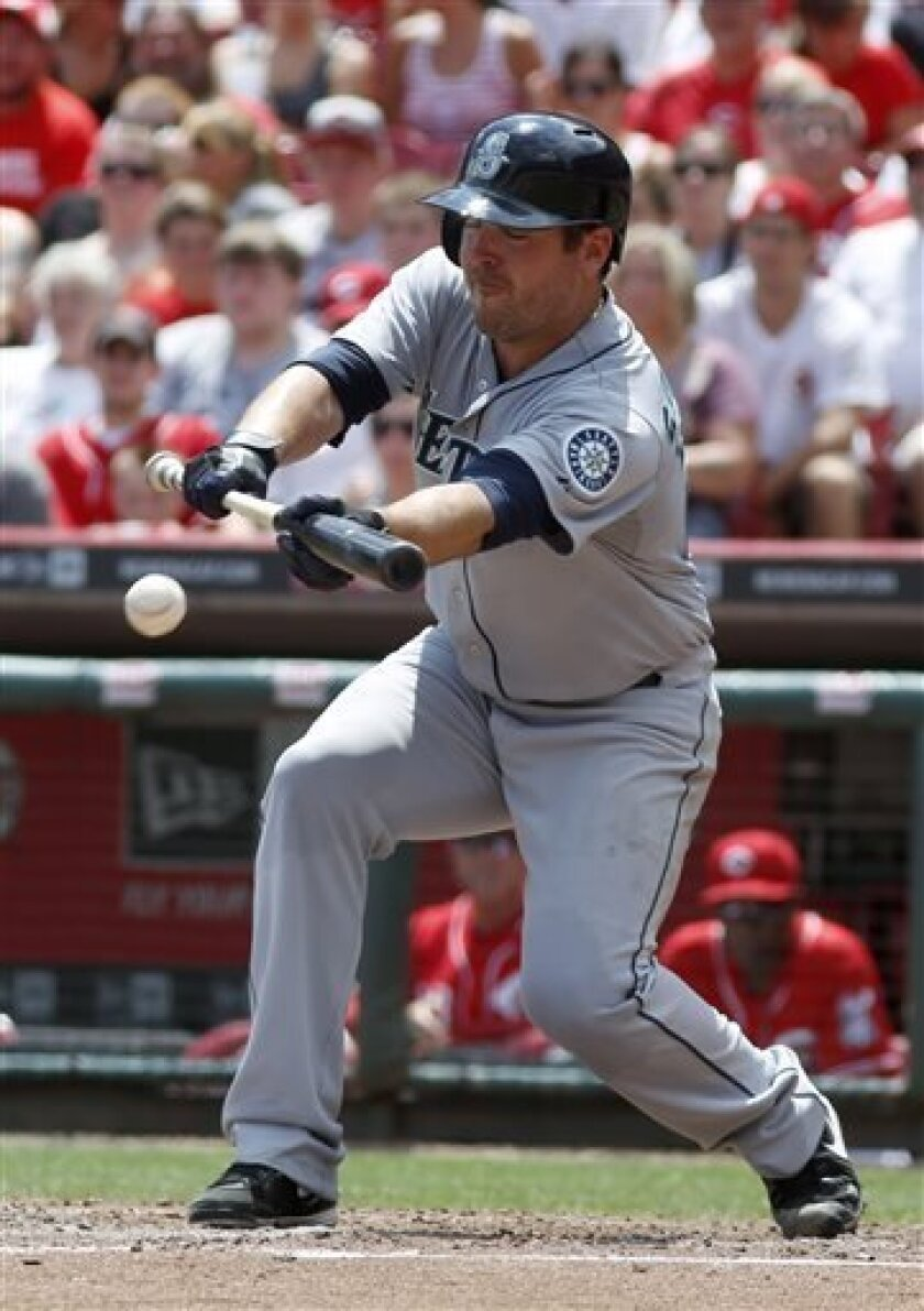 Seattle Mariners pitcher Joe Saunders bunts against Cincinnati Reds pitcher Alfredo Simon in the seventh inning during a baseball game, Sunday, July 7, 2013, in Cincinnati. Saunders was out on the sacrifice. (AP Photo/David Kohl)