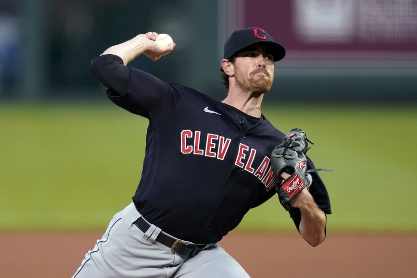 Cleveland Indians starting pitcher Shane Bieber throws during the first inning against the Kansas City Royals.