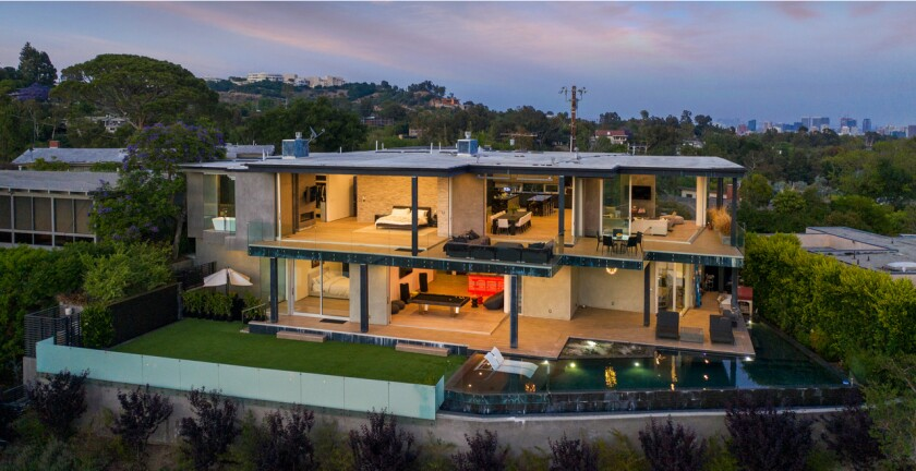 Built in 2016, the modern pad takes in sweeping city views from patios and decks.