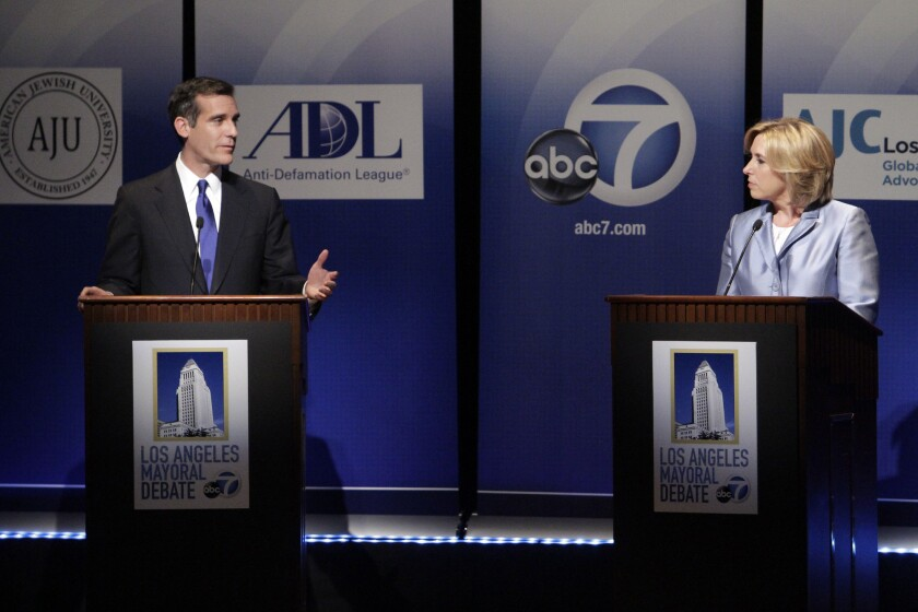 Mayoral candidates Wendy Greuel and Eric Garcetti in a televised debate last month.