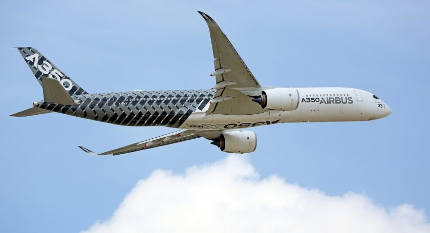 The new Airbus A350 performs its demonstration flight at the Paris Air Show in Le Bourget, north of Paris, Tuesday June 16, 2015. Some 300,000 aviation professionals and spectators are expected at this week's Paris Air Show, coming from around the world to make business deals and see dramatic displ
