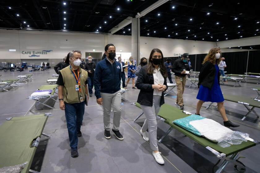 In March, California elected officials take a tour of the temporary youth shelter at the convention center.