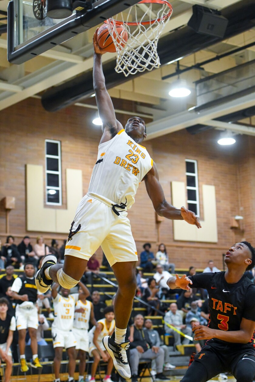 King/Drew's Fidelis Okereke rises for a dunk as Taft's Jason Hart Jr. watches.