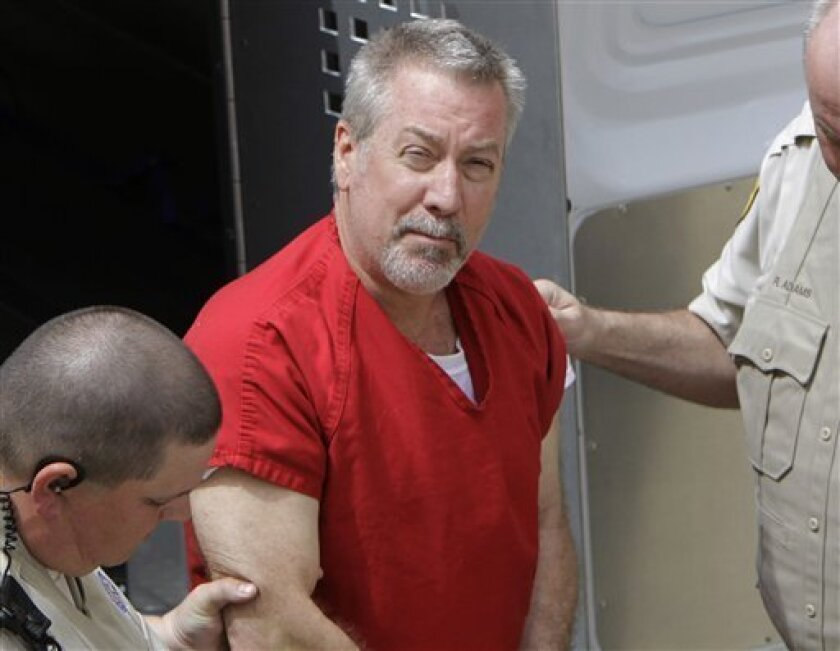 FILE - In this May 8, 2009 file photo, former Bolingbrook, Ill., police sergeant Drew Peterson arrives at the Will County Courthouse in Joliet, Ill., for his arraignment on charges of first-degree murder in the 2004 death of his former wife Kathleen Savio, who was found in an empty bathtub at home.