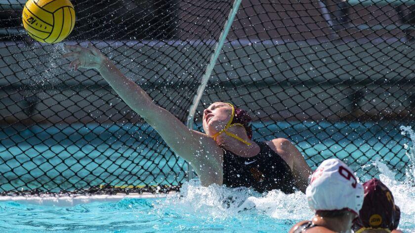 LOS ANGELES, CALIF. - MAY 13: USC Trojan Amanda Longan (1A) reaches for to block the goal attempt du