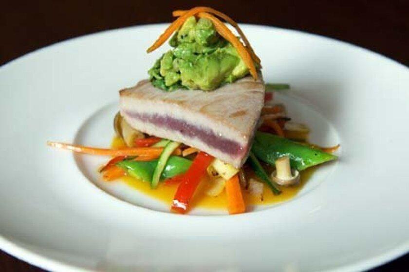 Seared ahi tuna with wok-fried vegetables, ponzu sauce and an avocado sesame relish.  Photo: Kelley Carlson