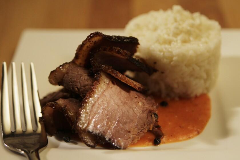 La Sandia's smoked brisket is served with cotija white rice and salsa pibil. Recipe