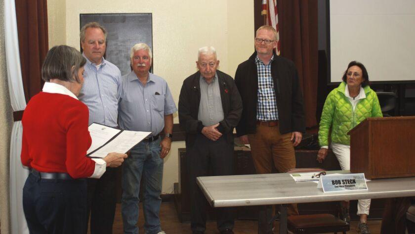 LJCPA trustee Janie Emerson swears in new board members Robert Steck, David Gordon, Bob Collins, Bri