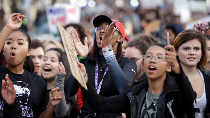 Students from Garfield High School march on Monday in Seattle with other young people who walked out of class to protest the election of Donald Trump.