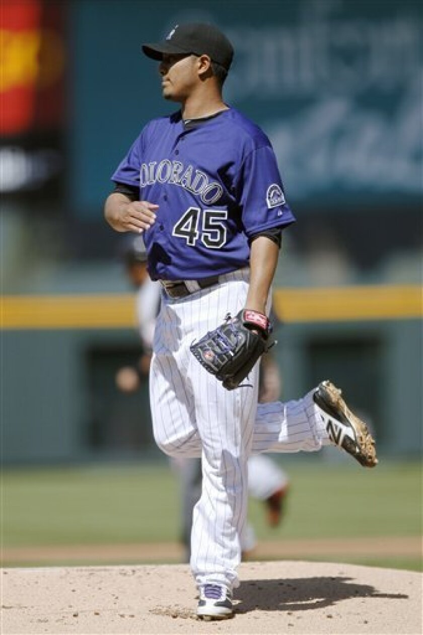 Colorado Rockies starting pitcher Jhoulys Chacin reacts after giving up a two-run home run to San Francisco Giants' Pablo Sandoval in the first inning of a baseball game in Denver on Monday, April 9, 2012. (AP Photo/David Zalubowski)