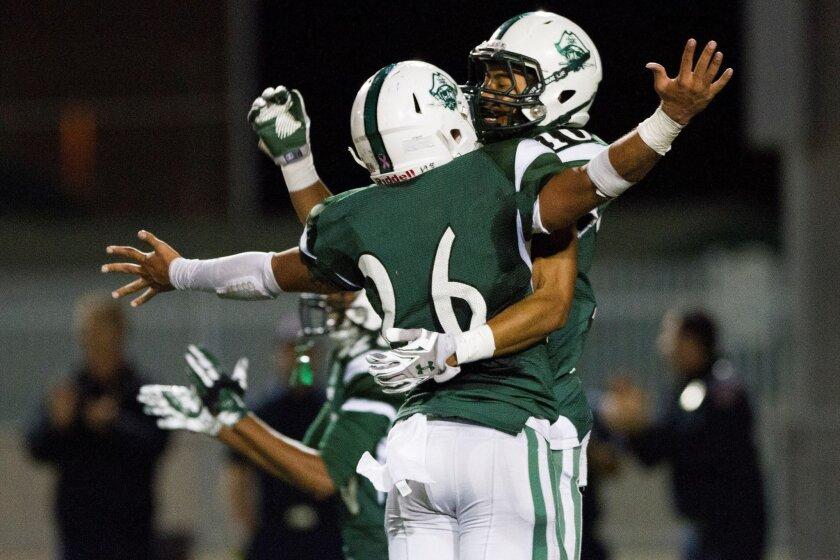 Oceanside's Taj Apodaca (right) celebrates his 51-yard touchdown reception with Niko Mageo.