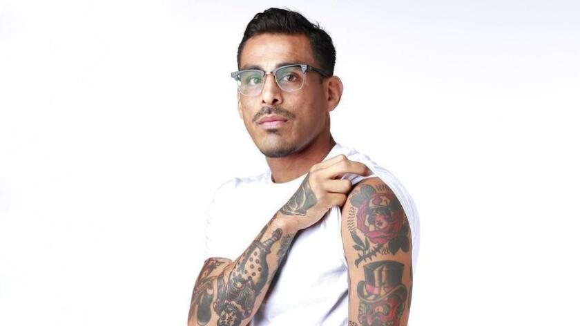 """Sergio """"Surge"""" Hernandez got his first tattoo at age 25, which he later covered up with a large chest piece. (K.C. Alfred)"""