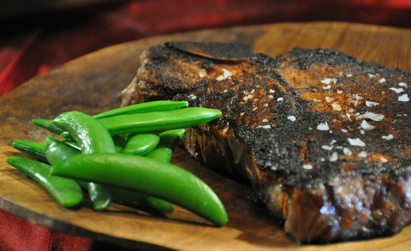 Roger Mooking's Cajun Blackened Steak With Sugar Snap Peas.