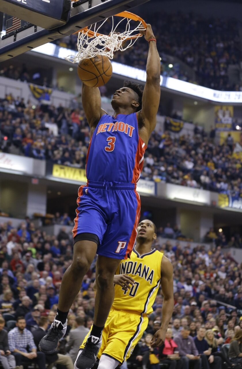 Detroit Pistons forward Stanley Johnson (3) gets a dunk on a fast break in front of Indiana Pacers guard Glenn Robinson III (40) during the first half of an NBA basketball game in Indianapolis, Saturday, Feb. 6, 2016. (AP Photo/Michael Conroy)