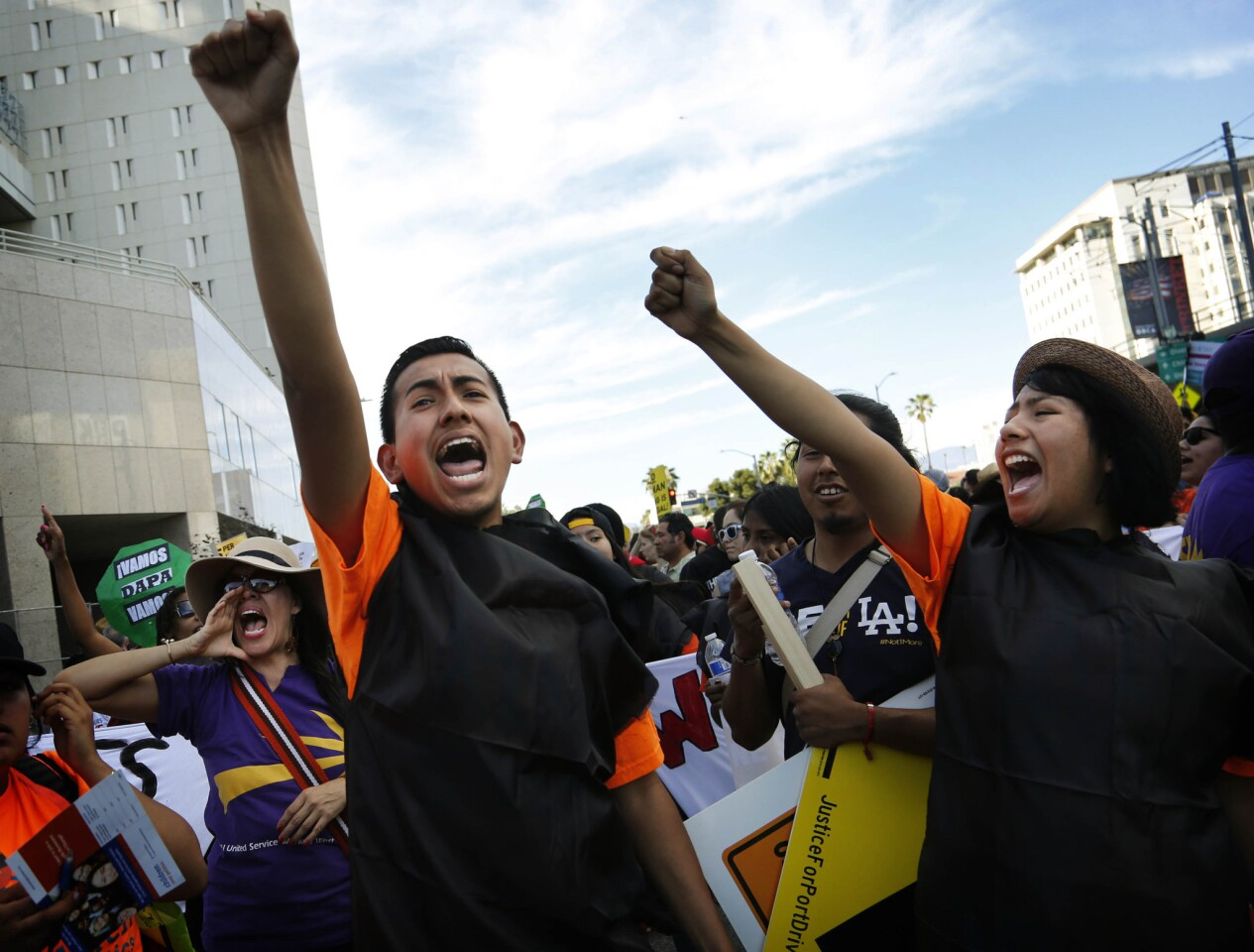 Jose Ramon Montes, left and Leticia Velez, of Children Over Politics, chant during a May Day March in downtown Los Angeles.