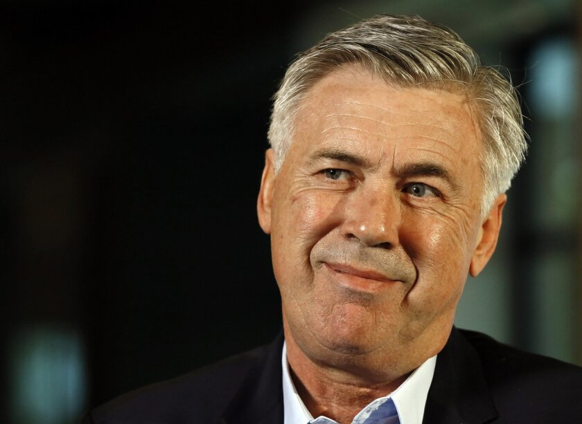 Carlo Ancelotti smiles during an interview in London, Wednesday, May 25, 2016. Carlo Ancelotti's next managerial assignment soon begins at Bayern Munich, and he still hasn't mastered German. Given how clubs casually dispose of managers, Ancelotti could be forgiven for focusing his studies on the Bavarian team's players rather than the native tongue. (AP Photo/Kirsty Wigglesworth)