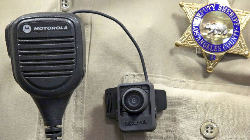 FILE - This Sept. 22, 2014 file photo shows a body camera on the uniform of a Los Angeles County She