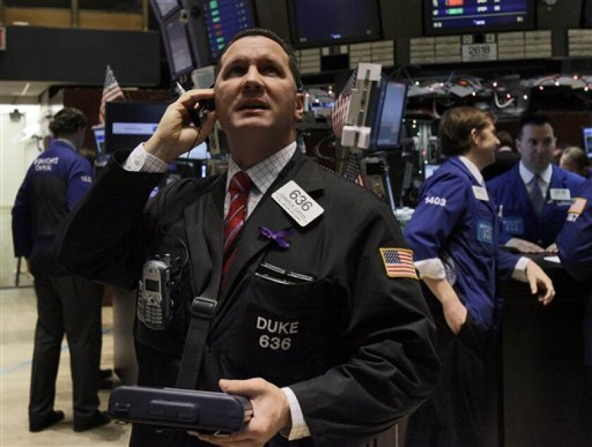 Trader Edward Curran checks prices as he works on the floor of the New York Stock Exchange Tuesday, Jan. 4, 2011. (AP Photo/Richard Drew)