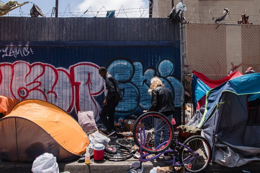 Tents and belongings of people living on the street can be seen on Commercial street.
