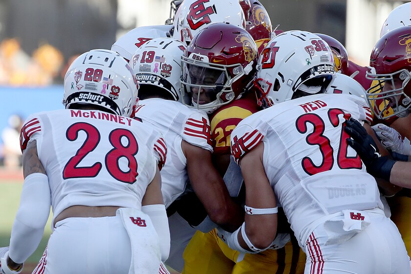 LOS ANGELES, CALIF. - OCT. 9, 2021. USC tailback Darwin Barlow gets wrapped up by the Utah defense.