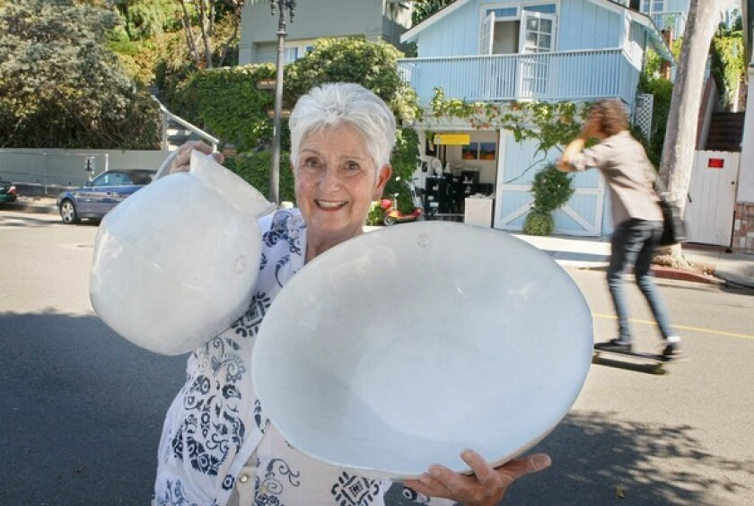 Ceramic artist Doreen Mellen in front of her Blue Cottage Studio.