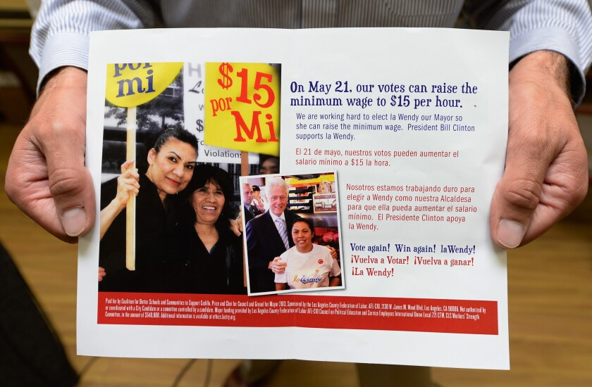 A campaign mailer sponsored in part by the Los Angeles County Federation of Labor implies that Wendy Greuel's election as mayor is key to raising the minimum wage to $15 an hour. The mailer does not clarify that the wage proposal is only for hotel workers.