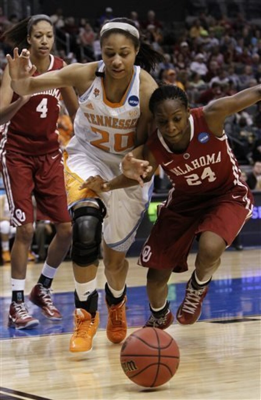 Tennessee's center Isabelle Harrison (20) and Oklahoma's guard Sharane Campbell (24) go after a loose ball in the second half of their game during the regional semifinal in the women's NCAA college basketball tournament in Oklahoma City Sunday March 31, 2013.  Tennessee won 74-59.   (AP Photo/Alonz