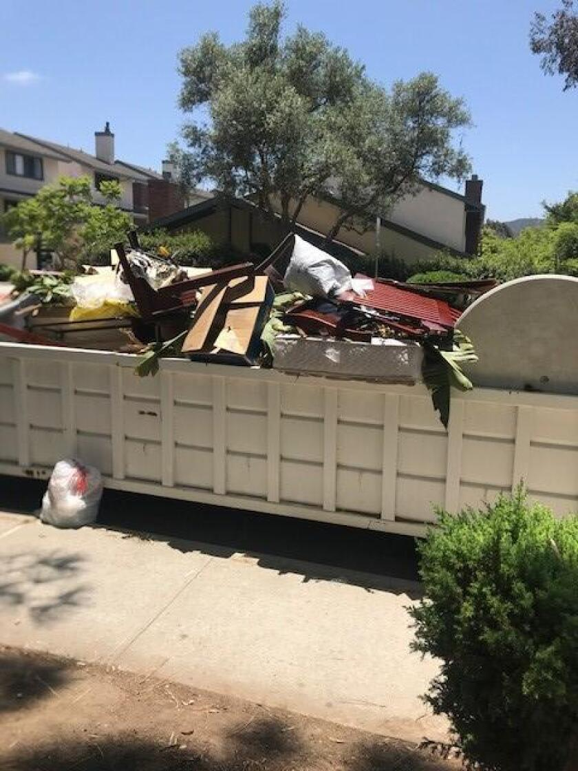 There has been a large white open to dumpster on the South side of Via Marin in front of the Villa La Jolla park since the beginning of January 2019. It has now become a trash dumpster with mattresses, furniture and other trash.