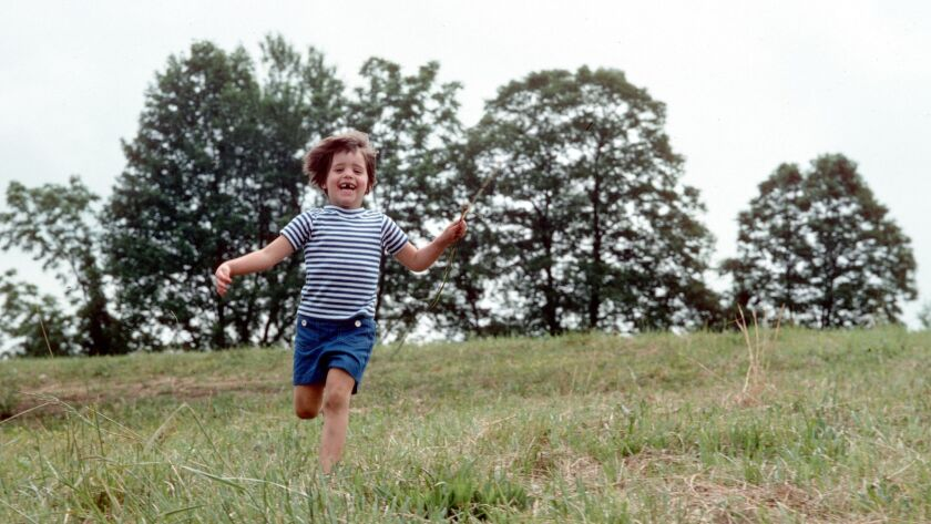 """Katie Arnold, author of """"Running Home,"""" as a child."""