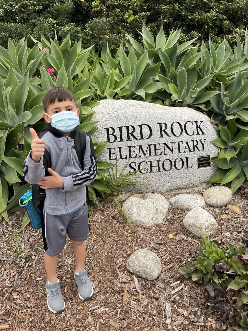Kindergartner Michael Lipkovicius signals he's ready for Bird Rock Elementary School.