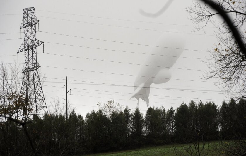 FILE - In this Oct. 28, 2015, file photo, an unmanned Army surveillance blimp floats through the air while dragging a tether line just south of Millville, Pa. The Pentagon says Defense Secretary Ash Carter supports resumption of a military exercise that was suspended last October when a radar-carry