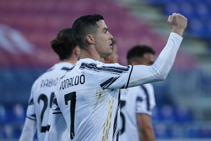 Juventus' Cristiano Ronaldo celebrates after scoring his side's second goal during the Italian Serie A soccer match between Cagliari and Juventus, at the Sardegna Arena stadium in Cagliari, Italy, Sunday, March 14, 2021. (Alessandro Tocco/LaPresse via AP)