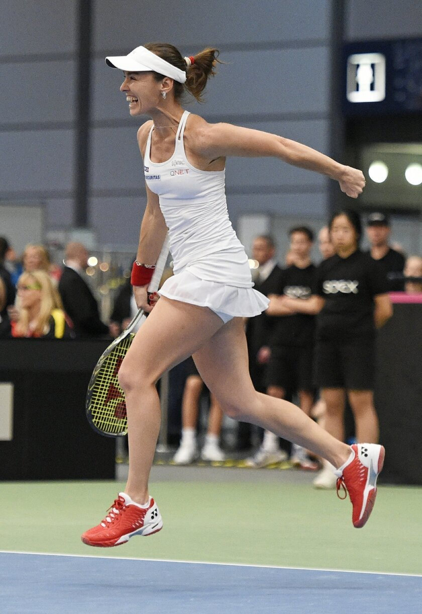 Martina Hingis of Switzerland celebrates after winning her doubles match during the Fed Cup World Group first round tennis match between Germany and Switzerland at the Leipzig Fair in Leipzig, Germany, Sunday, Feb. 7, 2016. (AP Photo/Jens Meyer)