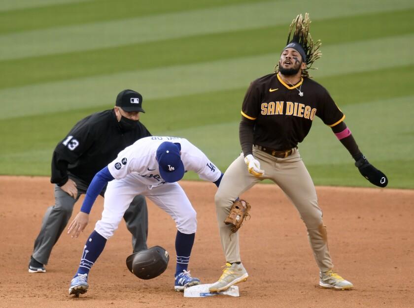 Fernando Tatis Jr. steals second base in the sixth inning Sunday at Dodger Stadium.