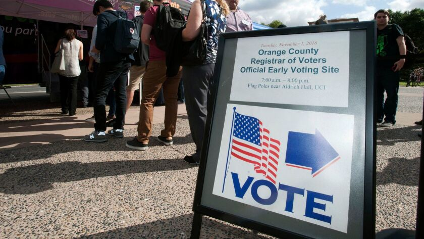 People stand in line at an early voting site in Irvine, Calif on Nov. 1, 2016.