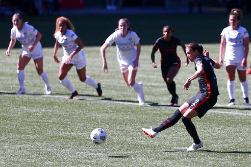 Thorns forward Christine Sinclair (#12) scores on a penalty kick to give the Portland Thorns a 2-0 lead over the Chicago Red Stars in an NWSL match at Providence Park on Sunday, May 16, 2021. (Sean Meagher/The Oregonian via AP)