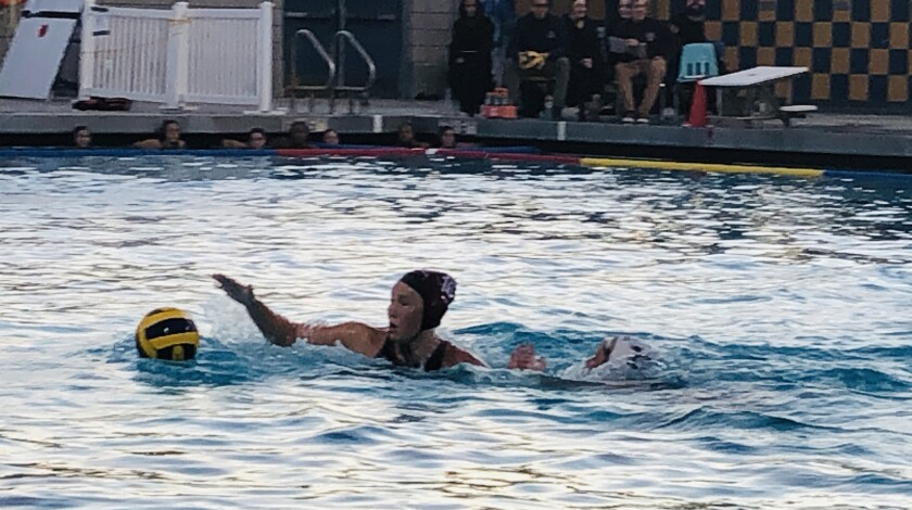 Laguna Beach's Nicole Struss, left, reaches for the ball against defense from Newport Harbor's Emily Cantu during the Santa Barbara Tournament of Champions title match on Saturday.