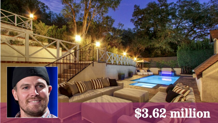 The English Tudor-style estate encompasses more than half an acre in Hollywood Hills.