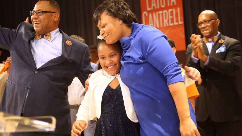 LaToya Cantrell hugs her daughter RayAnn as she celebrates her victory in the New Orleans mayoral election on Nov. 18.