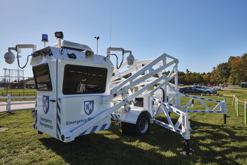 The SkyWatch booth is mounted on a trailer that is equipped with hydraulic lifts to raise and lower the platform.