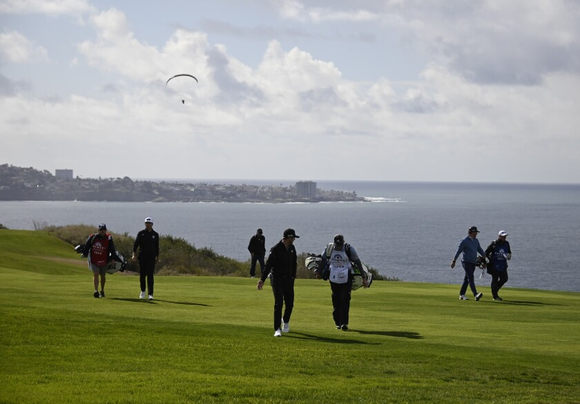 Golfers walk along the fourth hole of the South Course during the Farmers Insurance Open at Torrey Pines in January.