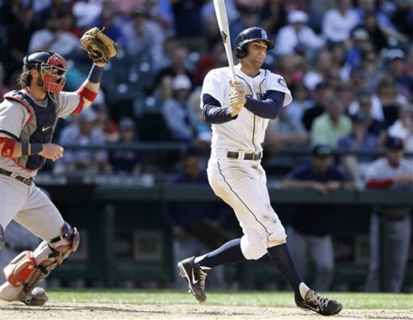 Seattle Mariners' Brad Miller, right, strikes out swinging as Boston Red Sox catcher Jarrod Saltalamacchia comes up from behind the plate as the baseball game ends in the 10th inning Thursday, July 11, 2013, in Seattle. The Red Sox won 8-7. (AP Photo/Elaine Thompson)