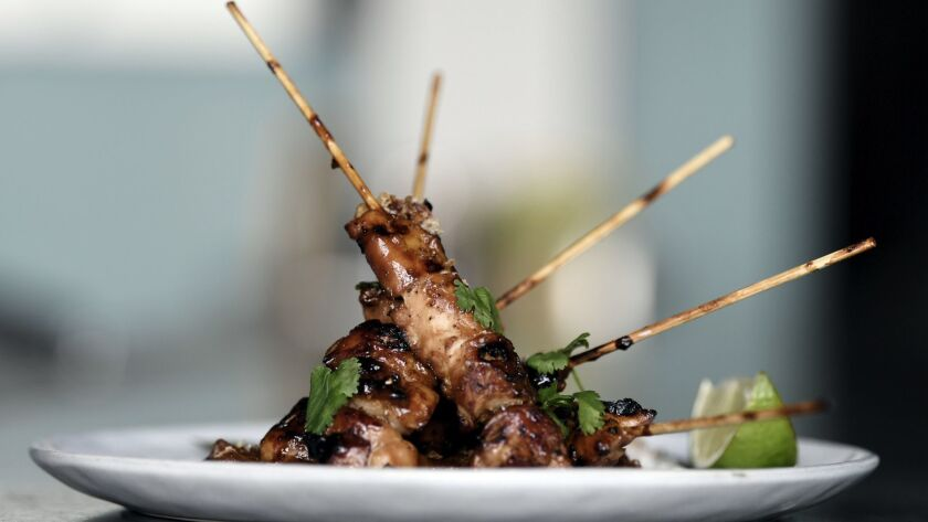 LOS ANGELES, CA-February 27, 2019: Sate Ayam: sweet soy glazed grilled chicken skewers with peanut s