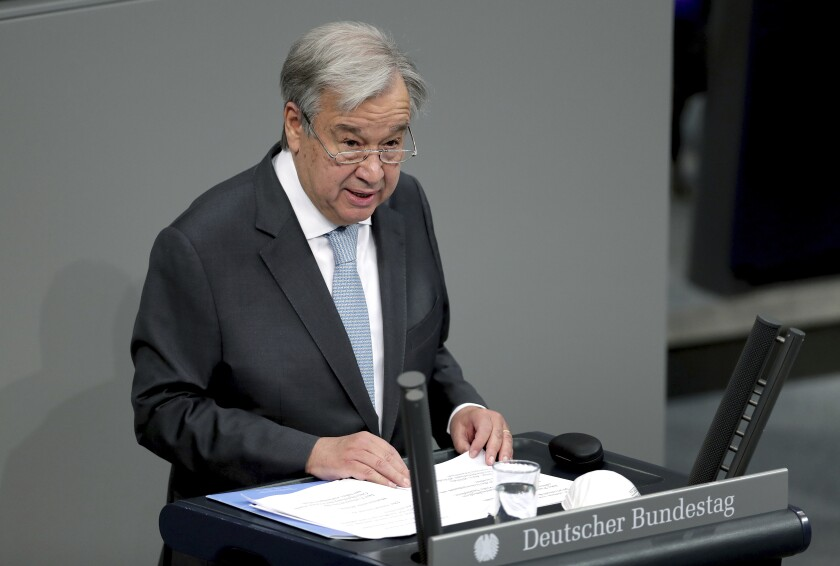 UN Secretary-General Antonio Guterres delivers a speech during a meeting of the German federal parliament, Bundestag, at the Reichstag building in Berlin, Germany, Friday, Dec. 18, 2020. (AP Photo/Michael Sohn)