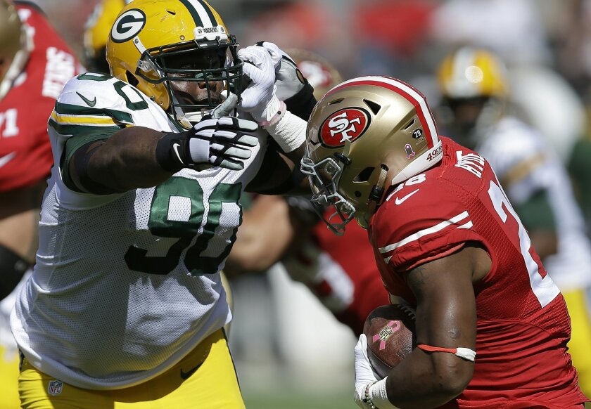 FILE - In this Oct. 4, 2015, file photo, Green Bay Packers nose tackle B.J. Raji (90) reaches for San Francisco 49ers running back Carlos Hyde during the first half of an NFL football game in Santa Clara, Calif. Raji hopes the Packers can learn from their mistakes after getting blown out by Denver