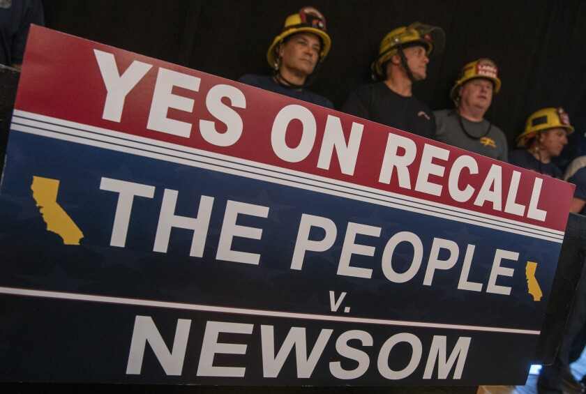 Firefighters wait for Republican presidential candidate Larry Elder to speak at a news conference in Glendale.