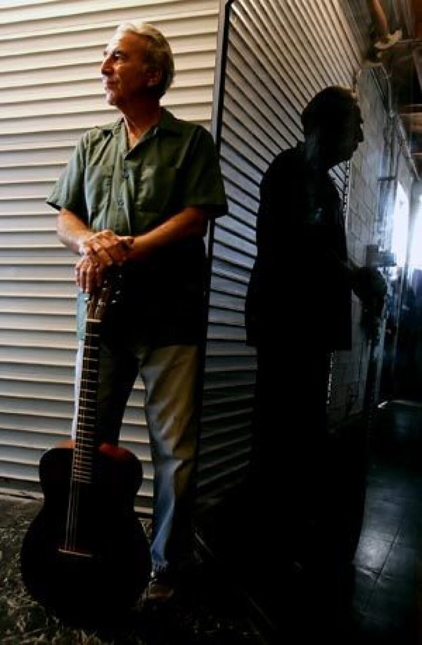 Blues guitarist Bernie Pearl with his vintage Martin guitar outside a recording studio.