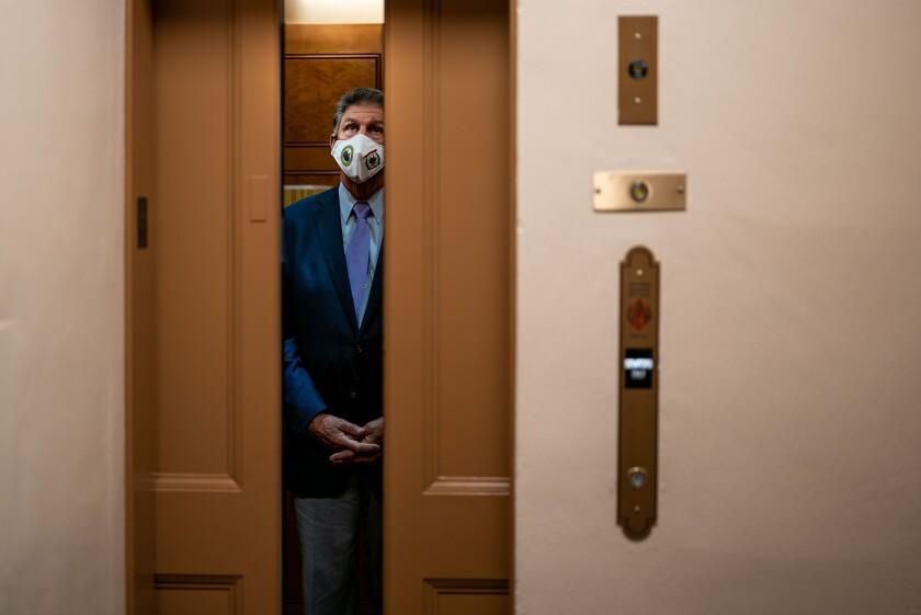 Sen. Joe Manchin (D-W.Va.) stands in an elevator near the Senate Subway on Capitol Hill on Aug. 5.