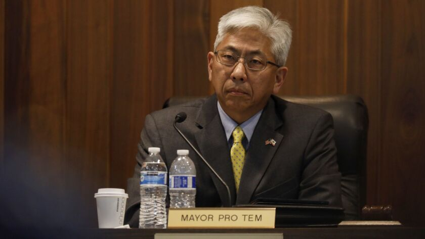 Los Alamitos Mayor Pro Tem Warren Kusumoto listens during public comments at a council meeting last month. He's been invited to meet with President Trump in the White House about immigration.