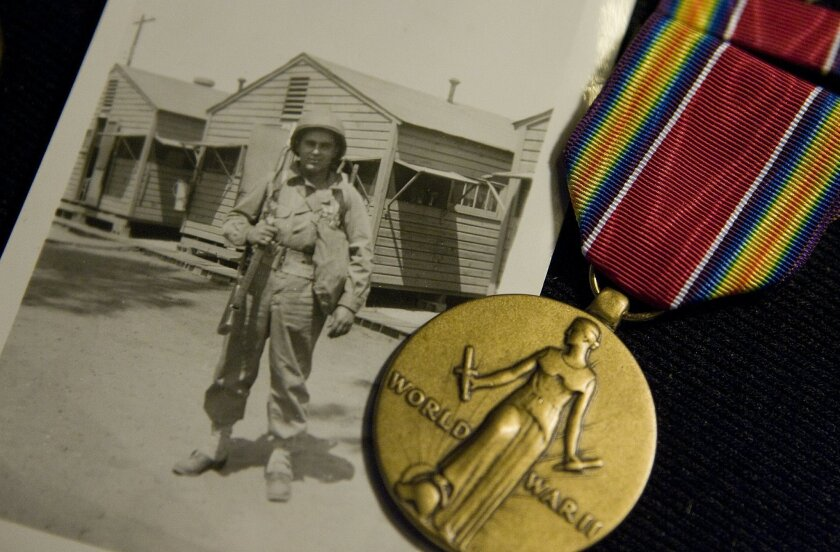 Photo of John D'Agostino taken in 1943 and the World War II Victory Medal he received for his service.